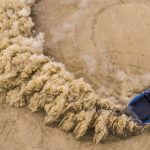 Outside Online image of car in dirt
