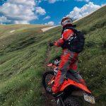 Rider on bike on mountain
